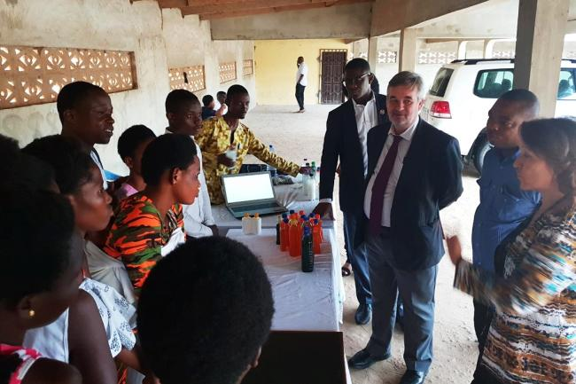 Some beneficiaries briefing the delegation including Mr. Christian Tardif, Ms Anne-Claire Dufay and Mr. Niyi Ojuolape
